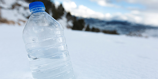 What Causes White Flakes in Bottled Water? - Absopure